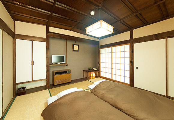 A Japanese-style 8-mat room with a bathroom